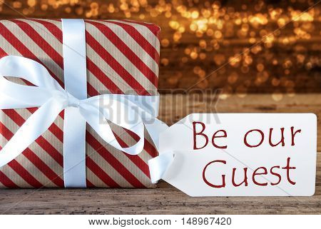 Macro Of Christmas Gift Or Present On Atmospheric Wooden Background. Card For Seasons Greetings, Best Wishes Or Congratulations. White Ribbon With Bow. English Text Happy Holidays