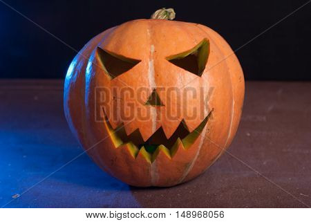 Jack-o ' - lantern on a wooden table, happy Halloween