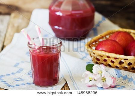 Useful plum juice in a glass on the table. Healthy and diet food. Selective focus