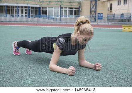Young Woman Goes In For Sports At The Stadium