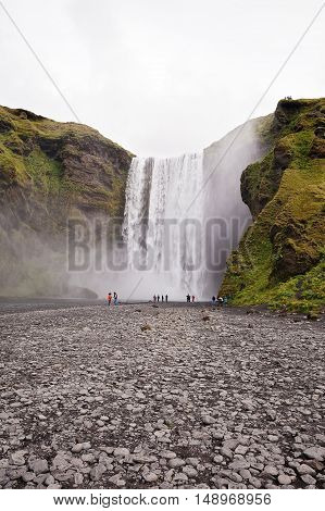 Skogafoss waterfall in Iceland with some people