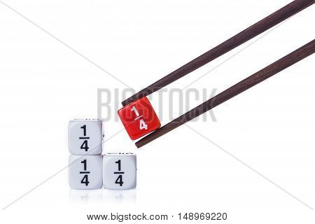 Three white quarter fraction dices on white table and red quarter fraction dice held by wooden chopsticks on isolated white background