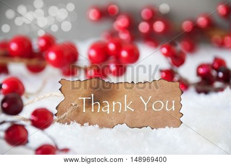 Burnt Label With English Text Thank You. Red Christmas Decoration On Snow. Cement Wall As Background With Bokeh Effect. Card For Seasons Greetings