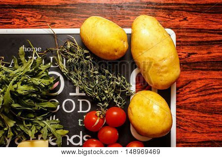Fresh farmers market fruit and vegetable with cheese on red table
