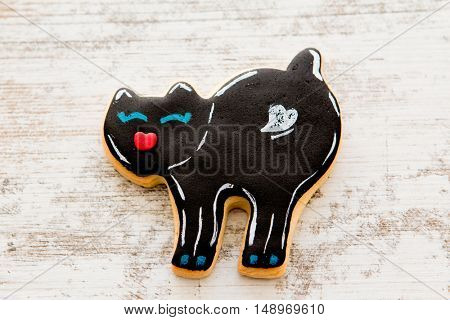Halloween cookie with black cat shape. Sweet tradition