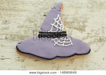 Halloween cookie with witch hat shape. Sweet tradition