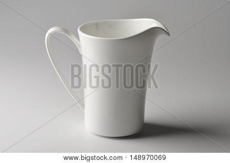 Milk jug of white porcelain isolated on white plane