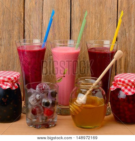 Set of berry smoothies jams and frozen berries