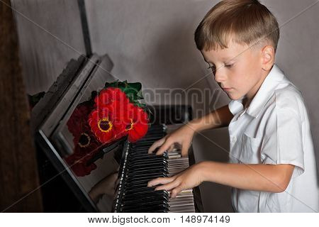 Pianist Boy With A Bouquet Of Flowers