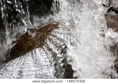 Splashes Of Water In A Small Waterfall