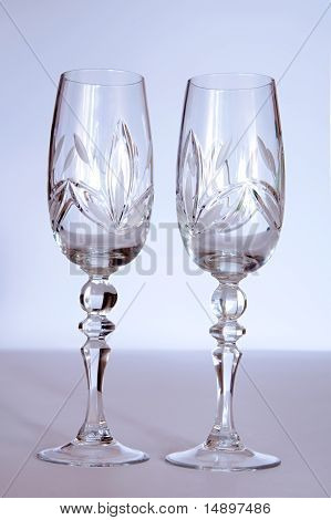 Two Crystal Wedding Glasses On A Gray Background