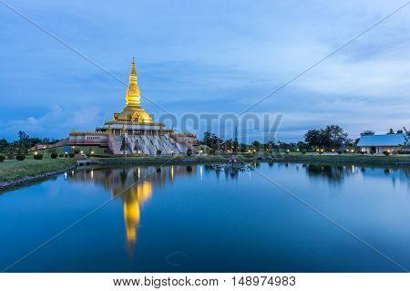 Maha Mongkol Bua Pagoda In Roi-ed Thailand At Sunset.
