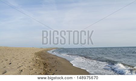 Sandy beach and the beautiful soft sky above