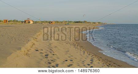 Beautiful sandy beach with soft blue sky above