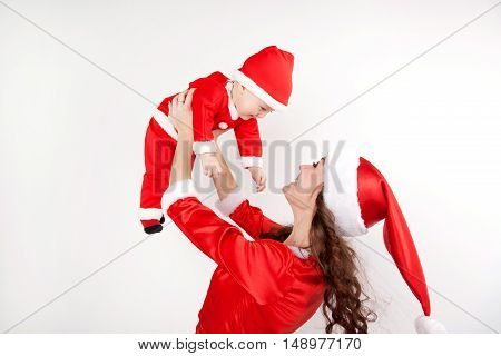 Christmas mother and baby having fun together. Christmas and new year concept.