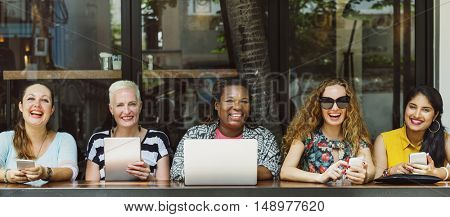 Group of Women Socialize Digital Device Connection Concept
