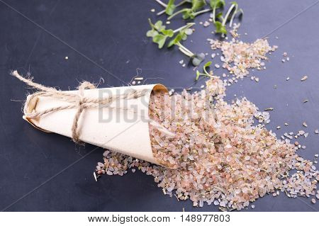 Himalayan Salt With Spices In A Paper Bag On A Black Background.