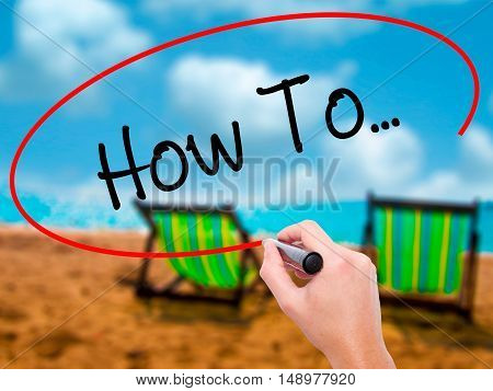 Man Hand Writing How To