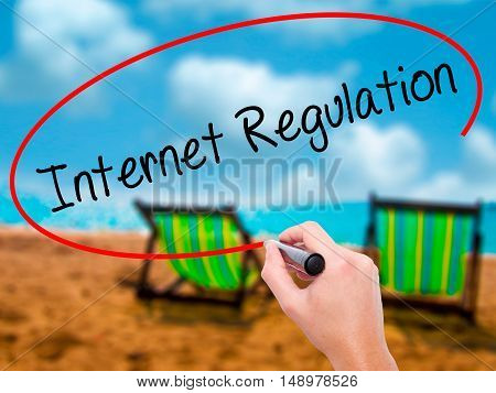 Man Hand Writing Internet Regulation With Black Marker On Visual Screen