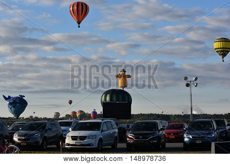 QUEENSBURY, NY - SEP 24: Balloon launch at dawn at the 2016 Adirondack Hot Air Balloon Festival held from Sep 22-25. Thousands of people attended the festival which is the largest of its kind on the East coast.