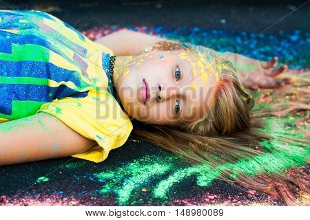 Woman in nature paint sprinkled Holi summer