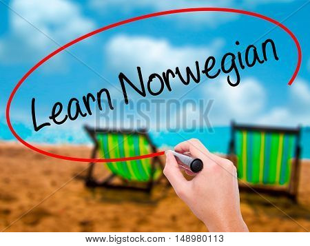 Man Hand Writing Learn Norwegian With Black Marker On Visual Screen.