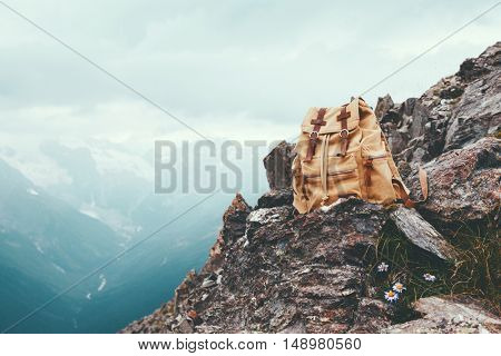 Travel backpack over alpine mountains view with snow, winter travelling