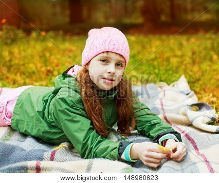 happy beautiful girl in the autumn park