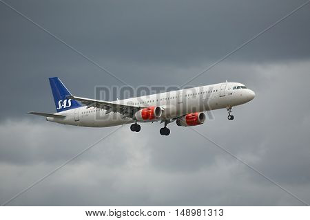 COPENHAGEN, DENMARK - MAY 13: SAS scandinavian airlines A321 approaching Kastrup Airport, May 13th 2015. SAS is the flag carrier of Sweden, Norway and Denmark.