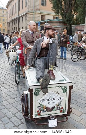 STOCKHOLM - SEPT 24 2016: Man sitting on a cycle used by gophers wearing old fashioned brown tweed clothes in the Bike in Tweed event September 24 2016 in Stockholm Sweden