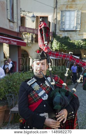 ORTA ITALY - SEPTEMBER 25 2016: Scottish bagpiper at public event in Orta Italy