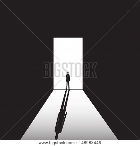 man standing on the bright and the dark background in the doorway with shadow