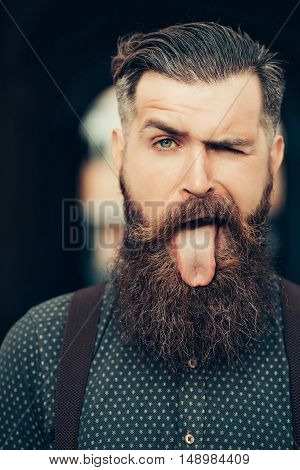 Handsome Bearded Man Showing Tongue