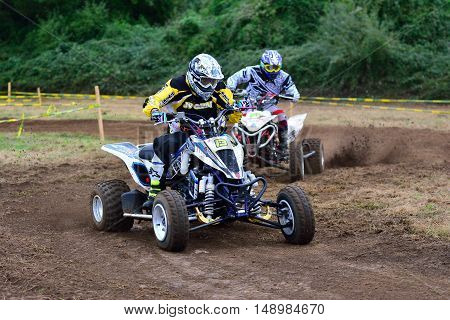 Unidentified Racer Rides A Quad Motorbike.