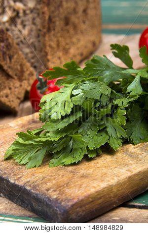 Closeup of a fresh parsley on a chopping board