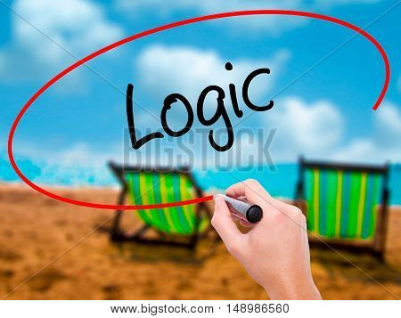 Man Hand Writing Logic With Black Marker On Visual Screen