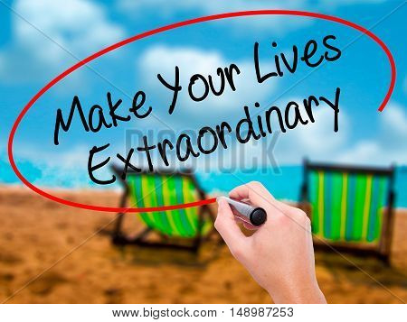 Man Hand Writing Make Your Lives Extraordinary With Black Marker On Visual Screen