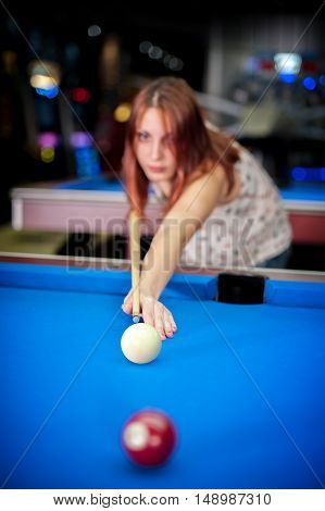 Young Woman Playing Pool Game In Pub
