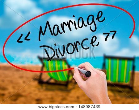 Man Hand Writing Marriage - Divorce With Black Marker On Visual Screen.