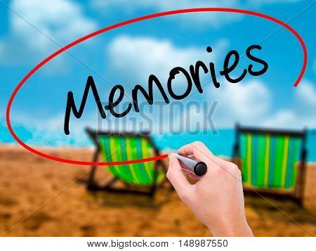 Man Hand Writing Memories With Black Marker On Visual Screen