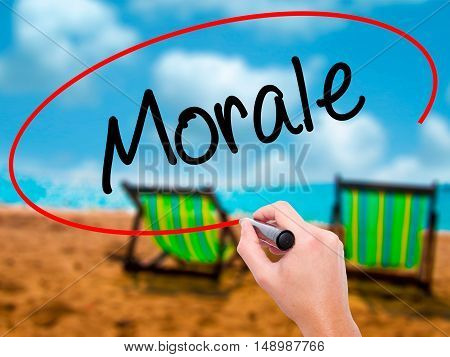 Man Hand Writing Morale With Black Marker On Visual Screen
