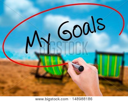 Man Hand Writing  My Goals With Black Marker On Visual Screen