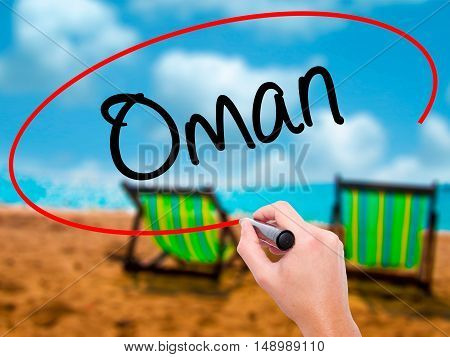 Man Hand Writing Oman   With Black Marker On Visual Screen