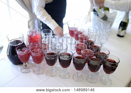 Beautiful wedding beverage for bride and groom indoors. Colorful couple glasses for alcohol. Beauty of bridal interior for marriage. Bright bar for celebration