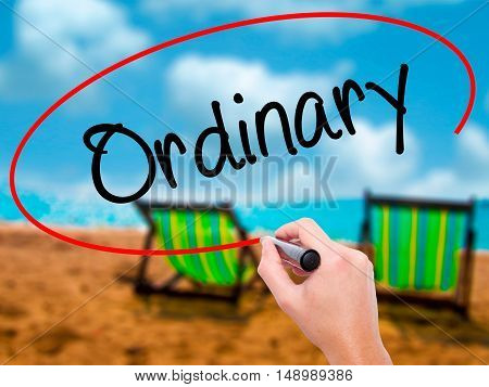 Man Hand Writing Ordinary With Black Marker On Visual Screen