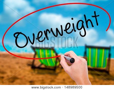 Man Hand Writing Overweight  With Black Marker On Visual Screen