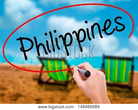 Man Hand Writing Philippines With Black Marker On Visual Screen