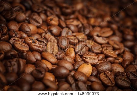 Closeup of brown coffee background. Macro photo of coffee beans