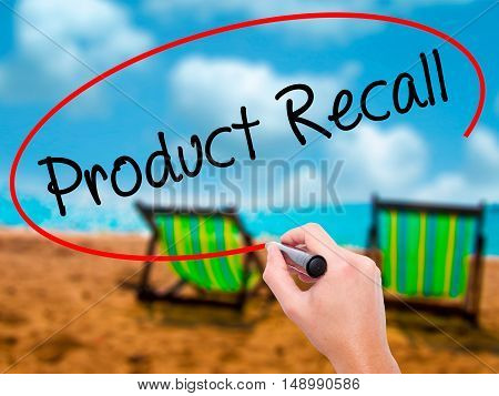 Man Hand Writing Product Recall With Black Marker On Visual Screen