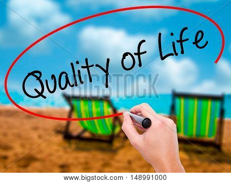 Man Hand Writing Quality Of Life With Black Marker On Visual Screen